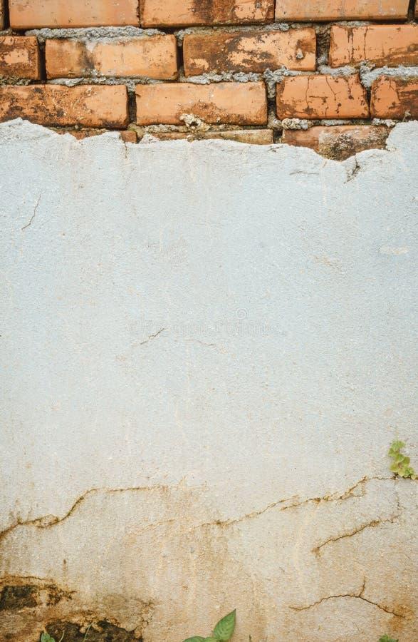 Cracked concrete brick wall royalty free stock photo