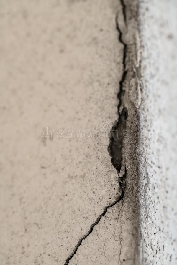 Cracked concrete from house corner background royalty free stock image