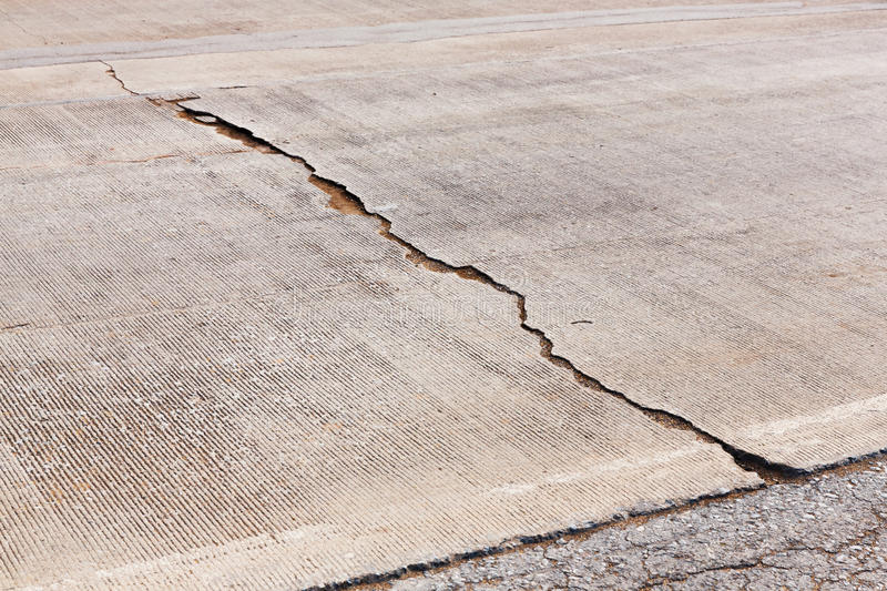 Cracked concrete road stock photo
