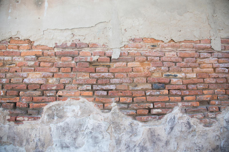 Cracked concrete vintage brick wall background stock photography