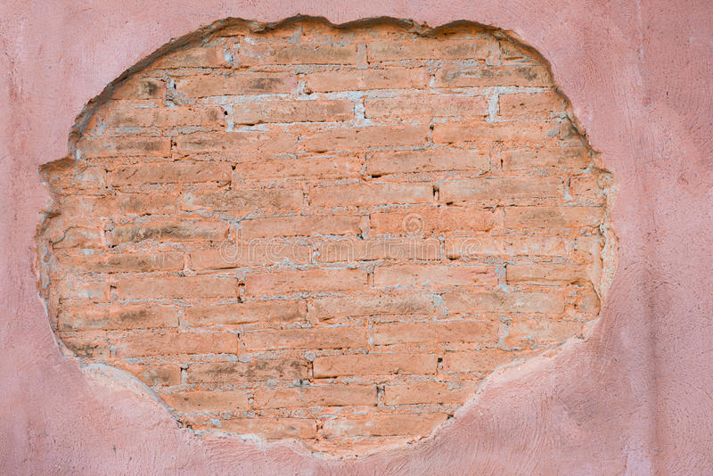 Cracked concrete vintage brick wall background.with space for text stock image