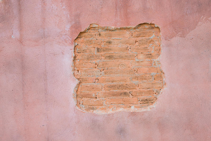 Cracked concrete vintage brick wall background.with space for text stock images
