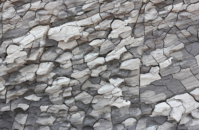 Cracked dry grey clay on the coast background picture royalty free stock photos