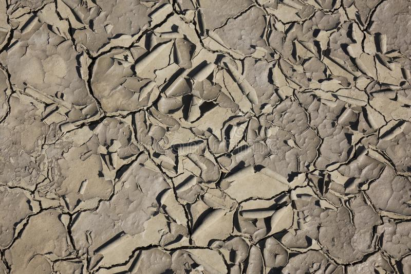 Cracked earth, cracked soil. texture of grungy dry cracking parched earth. Global worming effect royalty free stock images