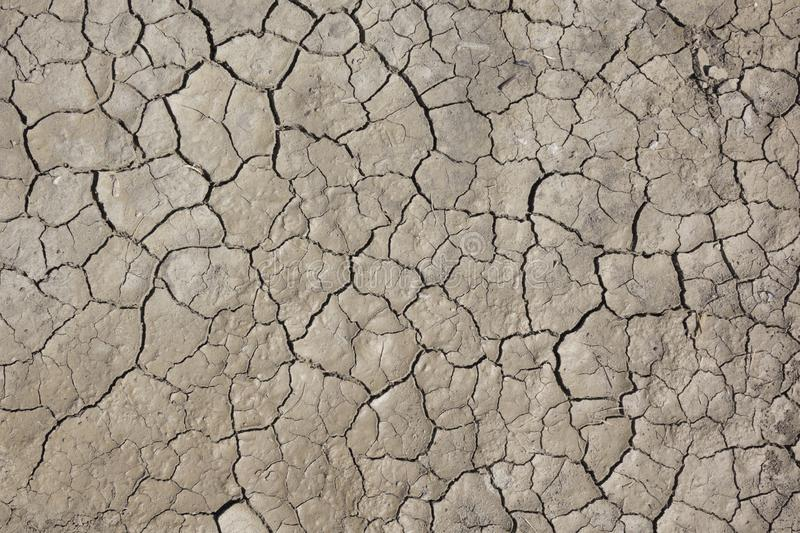 Cracked earth, cracked soil. texture of grungy dry cracking parched earth. Global worming effect stock images