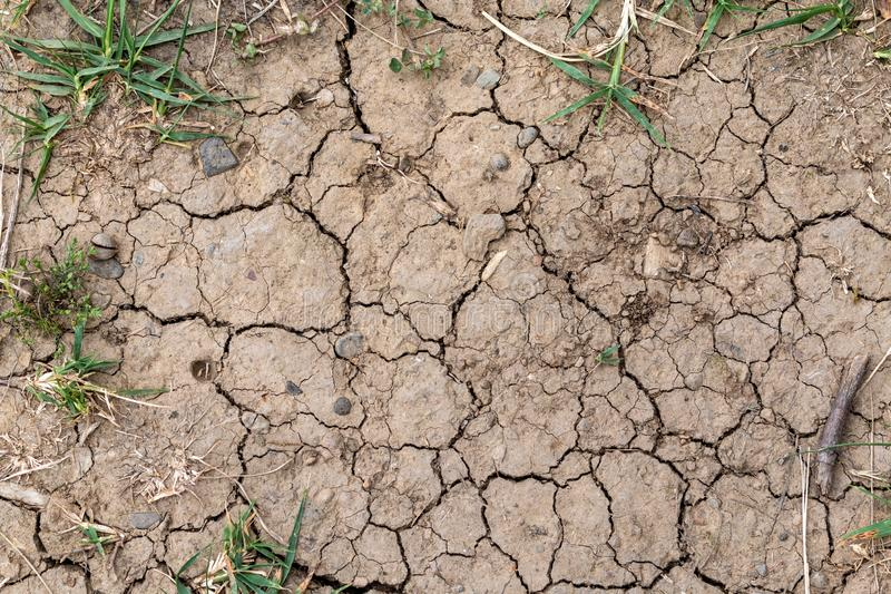Cracked earth - hot weather and climate crisis background. Cracked dry earth, overhead view. Environmental concerns and climate change concept royalty free stock photo