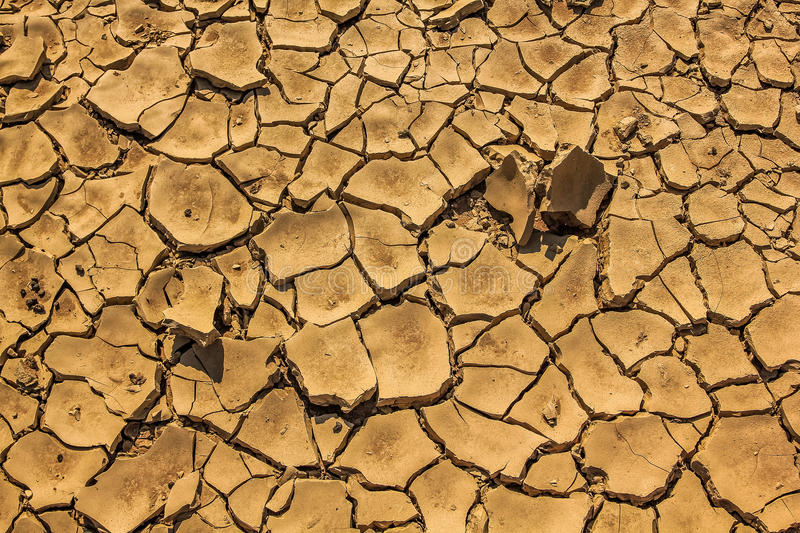 Cracked earth. In dry season in Namibian desert creating abstract textured background royalty free stock image