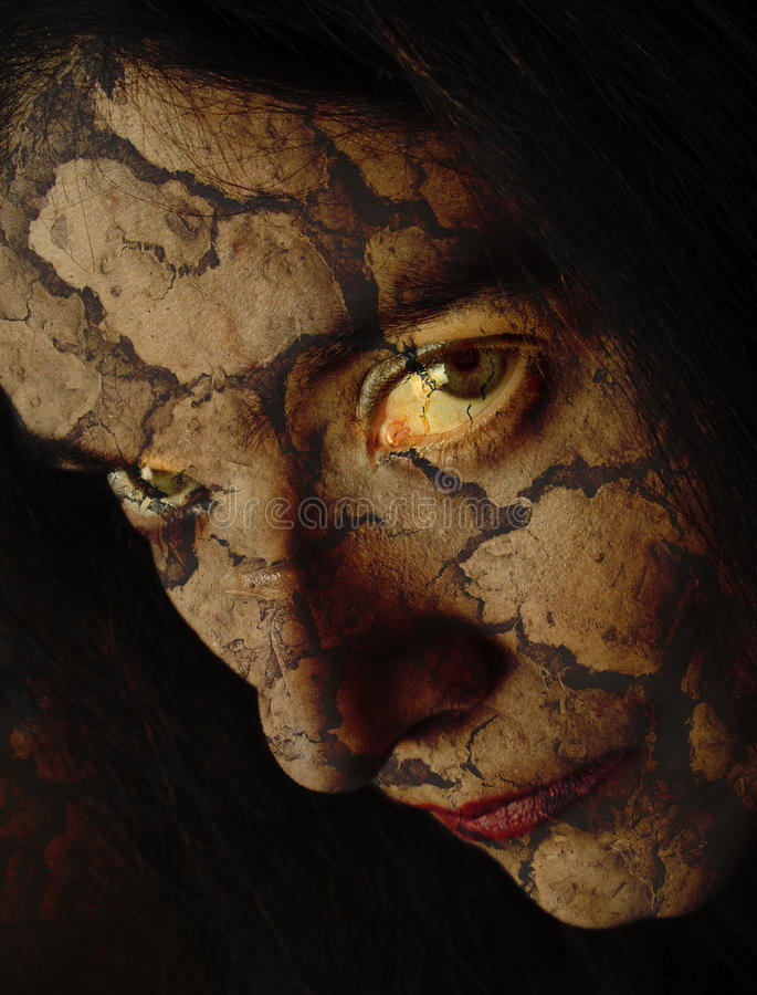 Cracked evil face. Close up on angry evil upset scary woman royalty free stock images