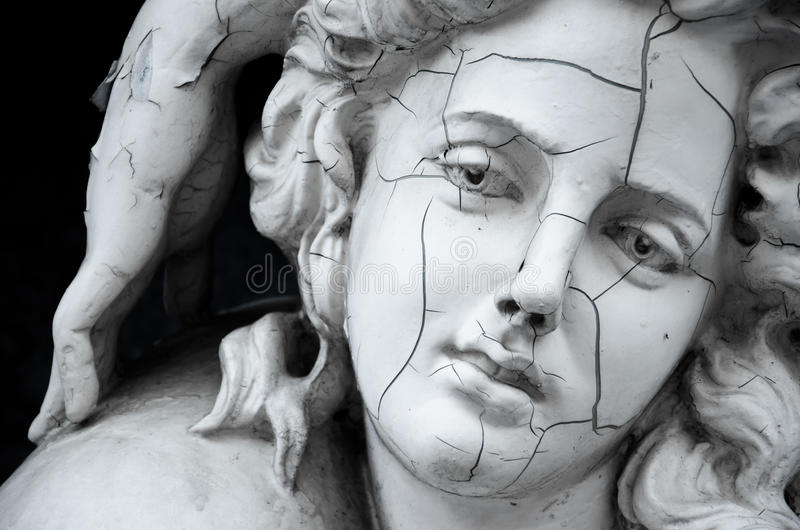 Cracked face of female Greek sculpture royalty free stock photos