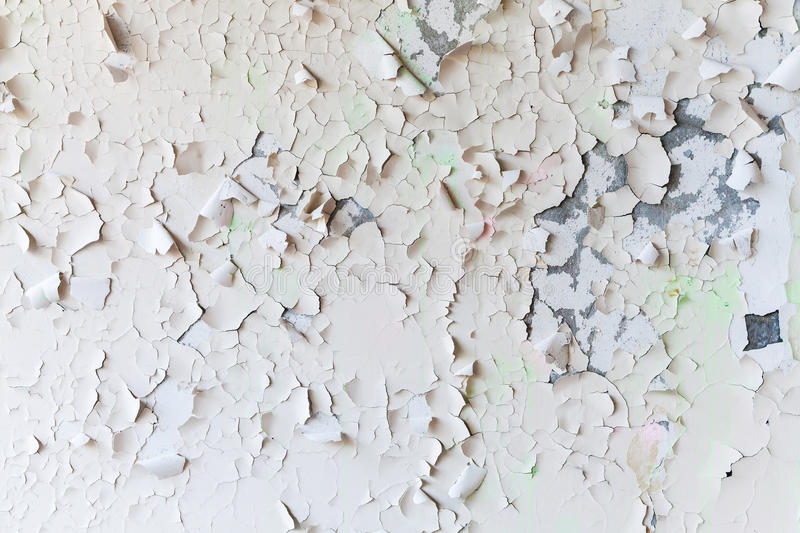 Cracked flaking paint on wall, background texture royalty free stock photos