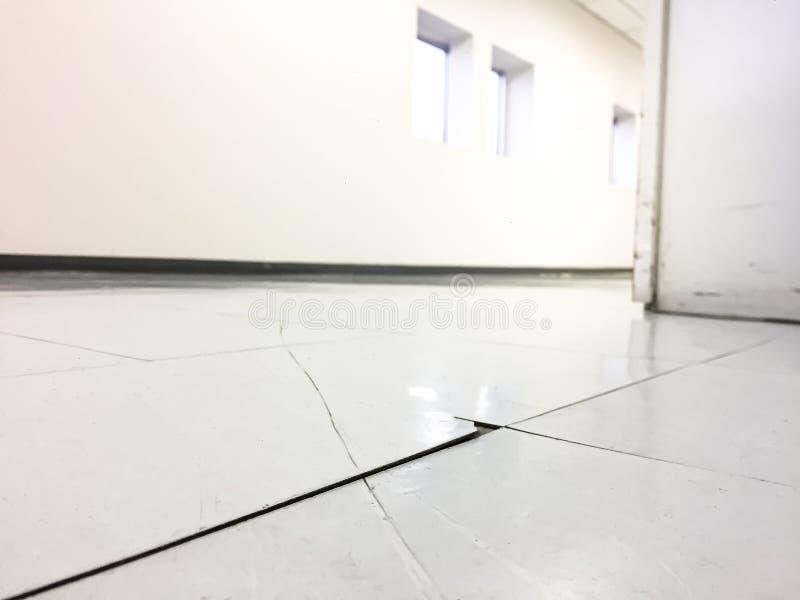 Cracked floor in factory,dilapidated building,broken corridor.  royalty free stock image