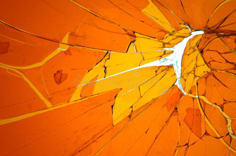Background with broken cracked glass. Colored glass stock image
