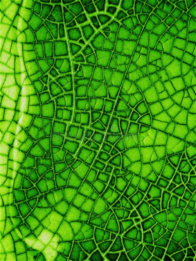 Cracked Glass Texture In Green royalty free stock photography