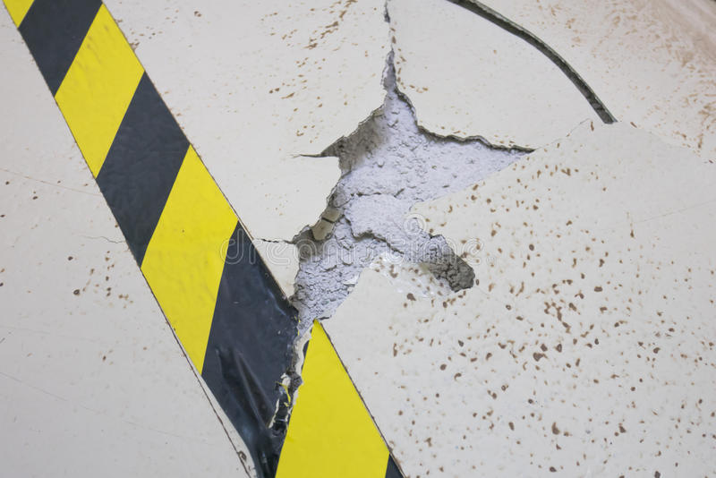 Cracked ground. Of factory in unsafe conditions stock photography