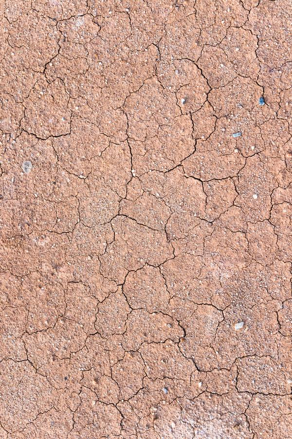 Cracked Land, Soil Texture with small pebble. Dry soil rough texture. Cracked Land, Soil Texture, Faded, Strong Reds, Yellow soil with small pebble. Dry soil royalty free stock photos