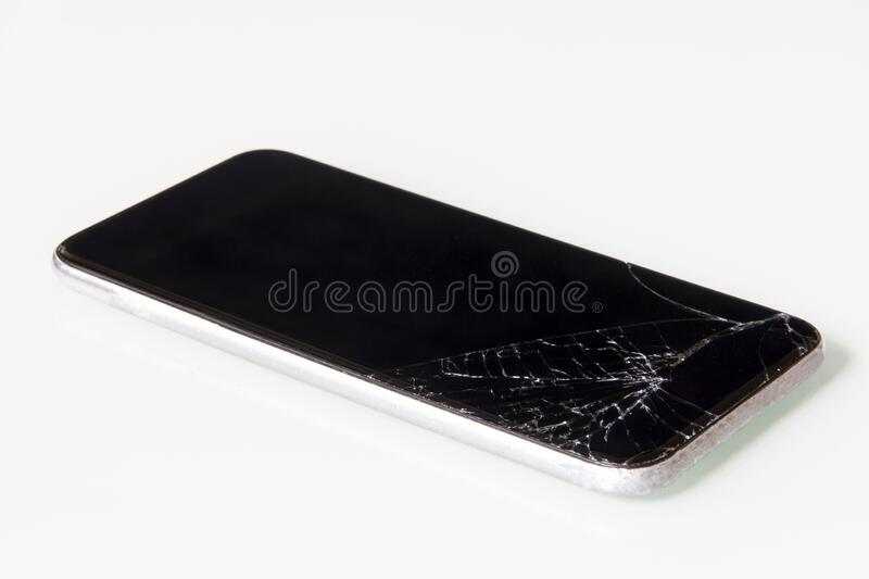 Cracked lcd touch screen on mobile phone in need of repair stock photo