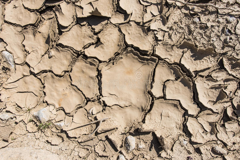 Cracked mud in the hot dry desert stock images