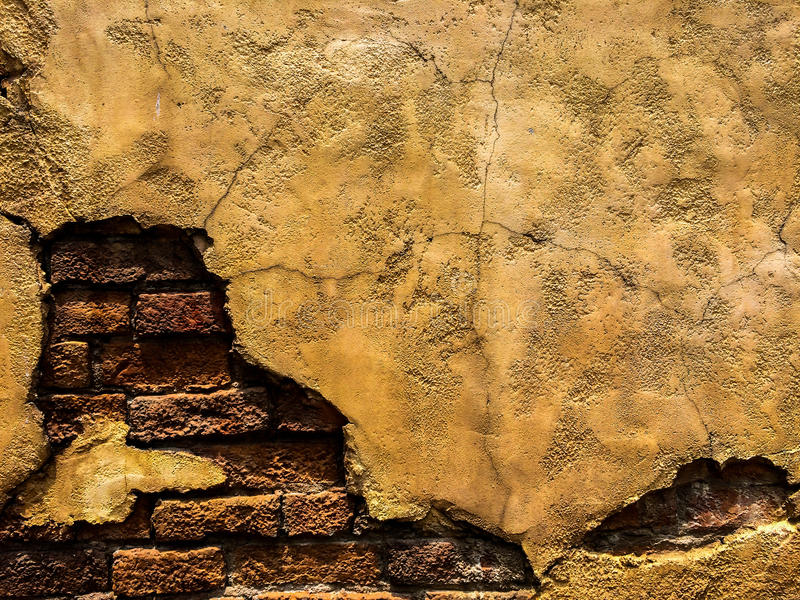 cracked old vintage brown concrete wall with brick