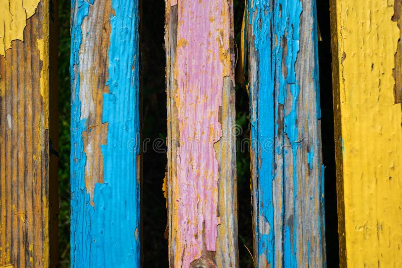 Cracked paint colored boards arranged vertically. Wooden background.  royalty free stock images