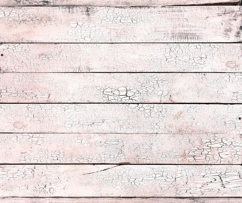 Cracked paint on light living coral old wooden background shabby texture stock photos