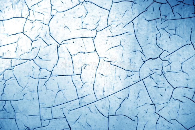 Cracked paint texture in navy blue color royalty free stock photo