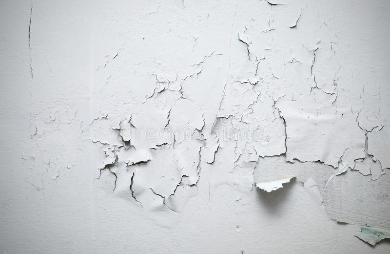 Cracked paint on wall in room stock photo