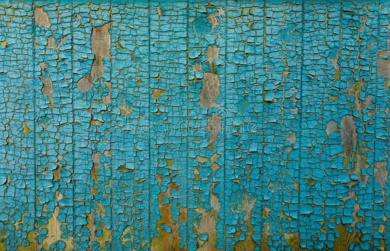 Cracked painted blue wall texture background royalty free stock image