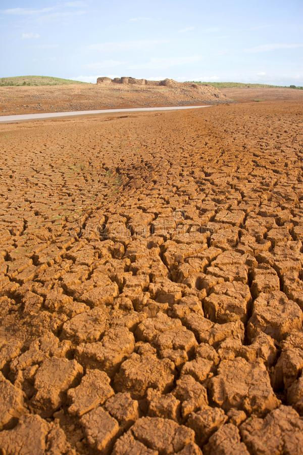 Cracked parched earth with fort. In background royalty free stock images