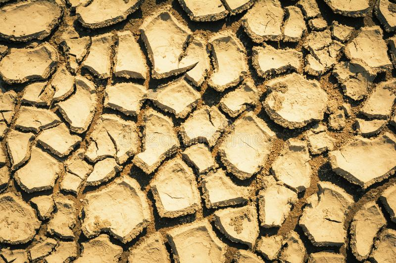 Cracked and parched earth in a lake bed. India, Cracked and parched earth in a river bed stock photo