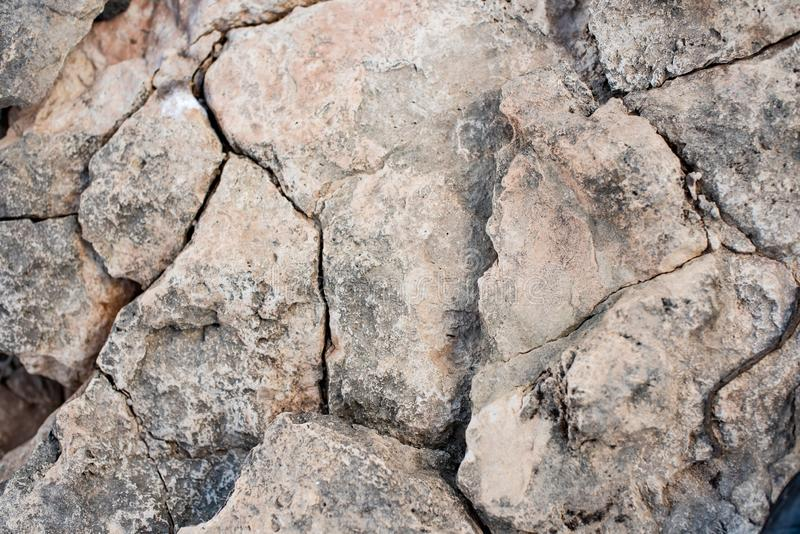 Cracked petrified clay soil as background royalty free stock photography