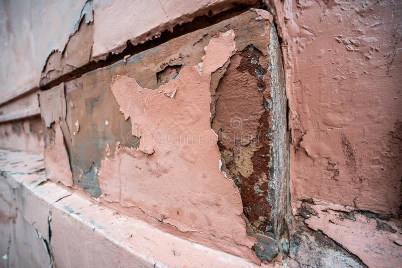 Cracked pink corner with fallen stucco royalty free stock image
