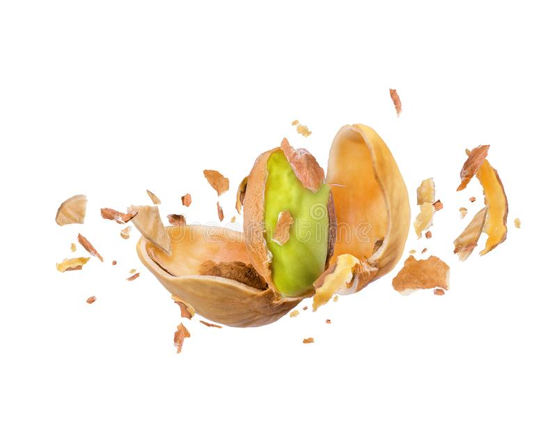 Cracked pistachio frozen in the air on a white. Background vector illustration
