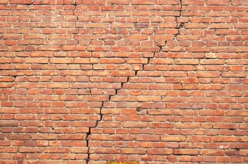 Cracked redbrick wall stock images