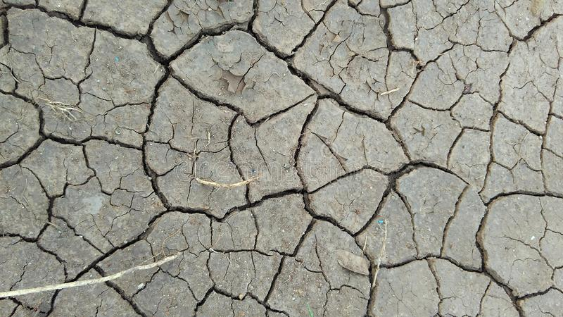 Dry soil texture cracked. Cracked sand texture in dry season, great for background and texture editing stock photo