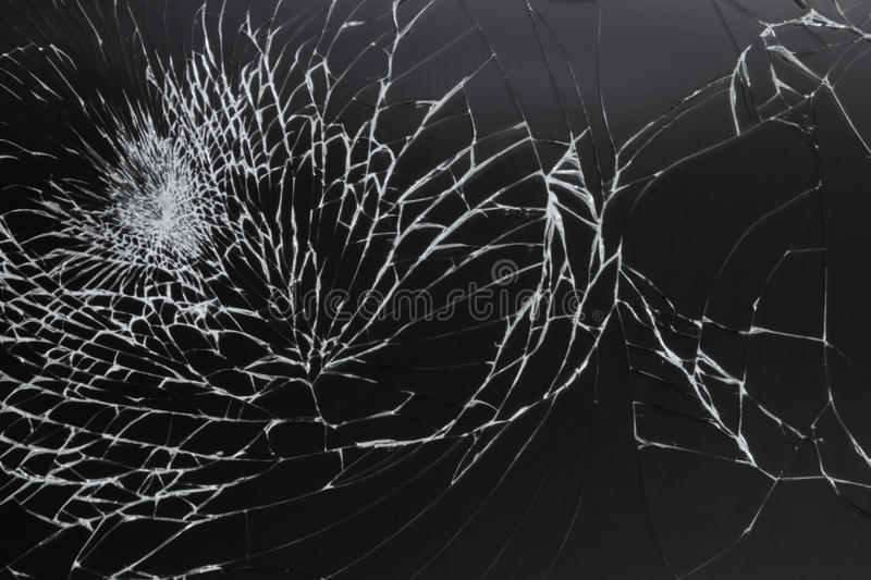 Cracked screen. Abstract - A cracked black tablet screen royalty free stock images