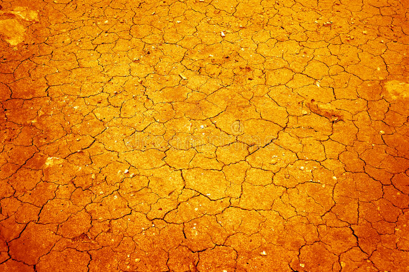 Cracked soil. A background image of dried and cracked soil royalty free stock photo
