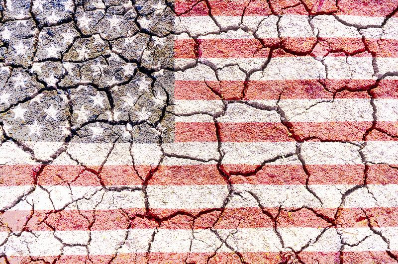 Cracked soil surface in dry season, brown tone texture backgroun royalty free stock image