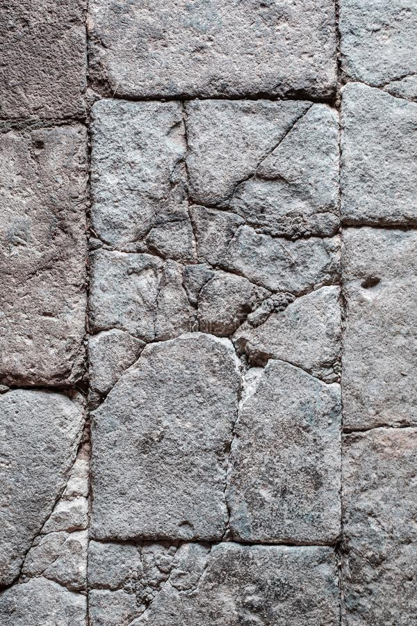 cracked stone blocks, antique tiled stone floor / wall with cracks stock images