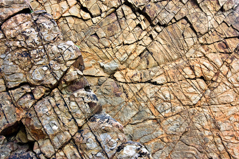 Cracked surface of cliff face stock image