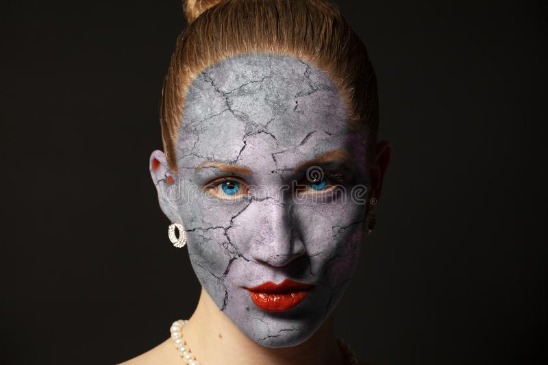 Cracked surface on woman face. Dry skin concept. royalty free stock image