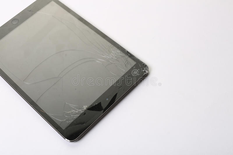 Cracked tablet screen. On white back ground stock photo