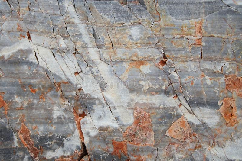 Cracked weathered ancient marble block. Textured stone background royalty free stock images