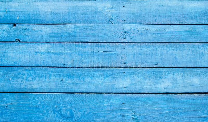 Cracked weathered blue shabby chic painted wooden board texture. Front view royalty free stock photo
