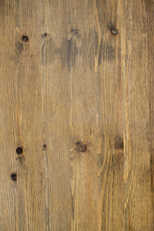 Cracked weathered brown painted wooden board texture royalty free stock image