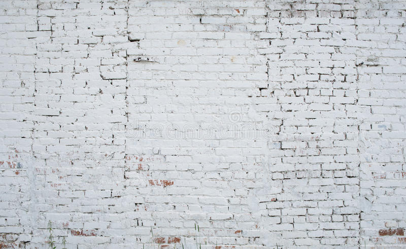 Cracked white grunge brick wall textured royalty free stock image