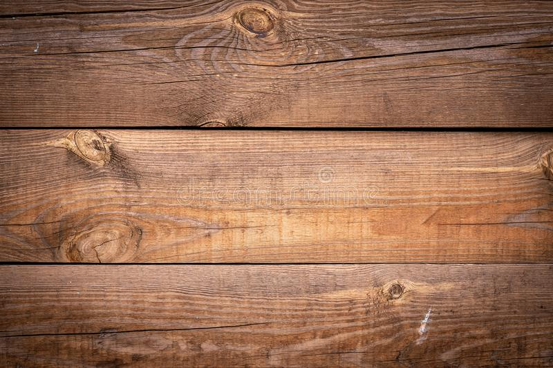Cracked wooden background. Horizontal lines on wood fence. Vintage rustic pattern for decoration design. Brown desk. Timber plank, royalty free stock photos