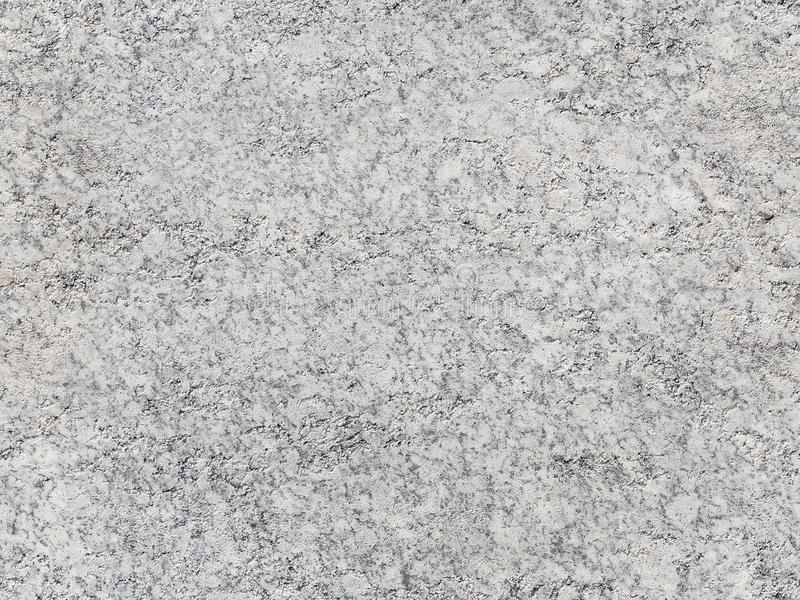 Cracked worn natural seamless granite stone texture pattern background. Natural white granite seamless stone texture. Seamless gra royalty free stock photography