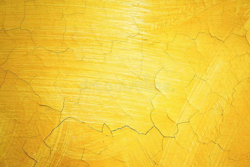 Cracked yellow paint on wall. Old exterior surface texture. Architecture concept. Text space royalty free stock image