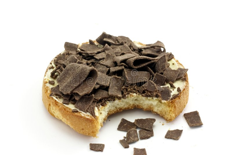 Cracker with butter and chocolate flakes. A typical dutch delicacy isolated on white stock photo