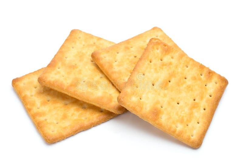 Cracker gestapelt lokalisiert über weißem Hintergrund lizenzfreie stockfotos